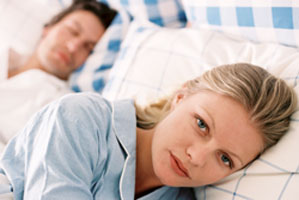 Frustrated woman can't sleep next to snoring man