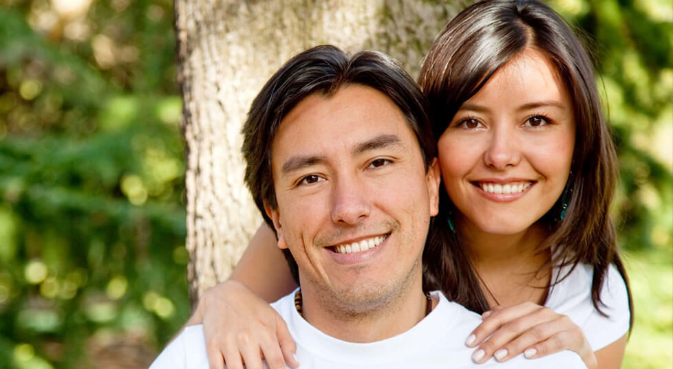 Smiling man and woman with gorgeous healthy teeth