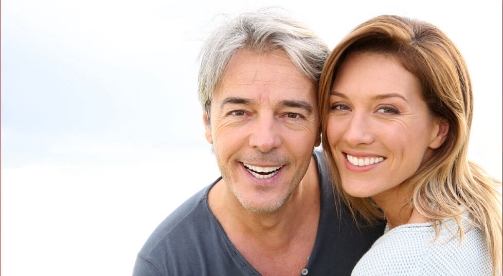 Older couple with beautiful healthy smiles