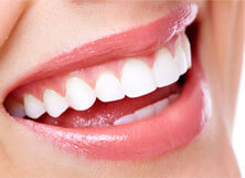Closeup of beautiful smile with dental crowns