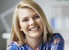 Young woman with perfectly straight smile