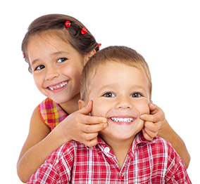 Boy and girl smiling happily