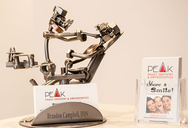 Office business cards in metal dentist and patient sculpture